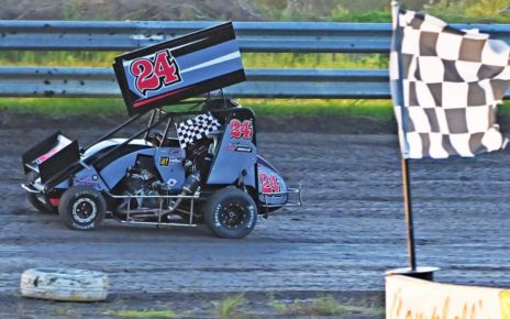 Ryder Wells takes a victory lap after capturing heat win at Gulf Coast Speedway