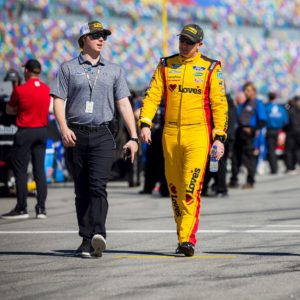 Mac MacLeod walks down the grid with NASCAR driver Michael McDowell. Photo courtesy of Harold Hinson Photography.