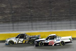 Sheldon Creed (2) battles rookie Tanner Gray (15) at Vegas. They went on to finish second and third in the 2020 World of Westgate 200. Photo by Nigel Kinrade Photography.
