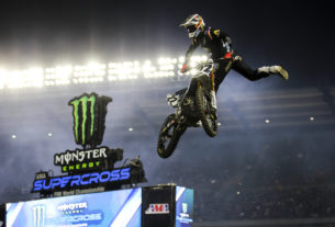 Chad Reed throws a Nac-Nac to the fans at Anaheim 2 in 2020 during his last full-time season with the Monster Energy AMA Supercross series. Photo by Rachel Schuoler / Kickin' the Tires.