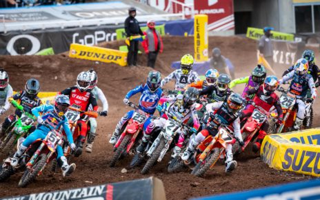 The field dives into the first turn after the gate drop for the 450SX race at SLC1. Photo by Feld Entertainment, Inc.