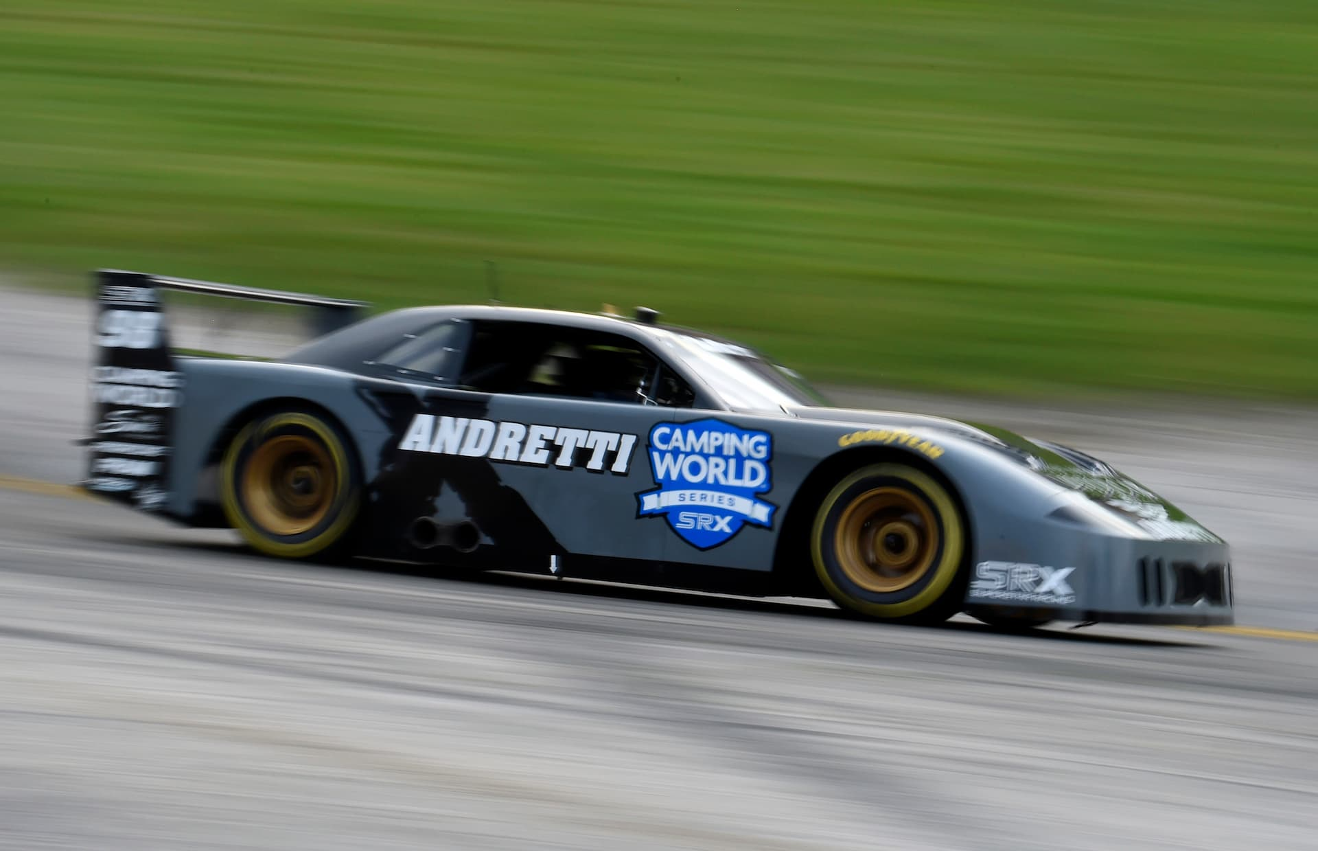 Marco Andretti races his way around Luke Fenhaus for the Round 5 SRX win at Slinger Speedway.