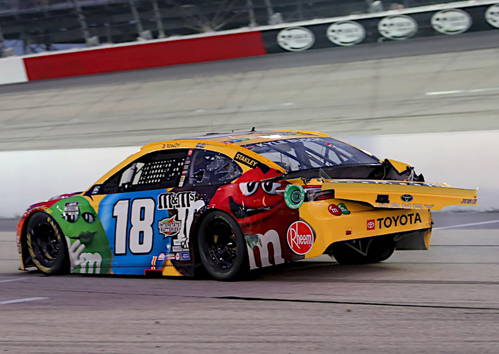 Kyle Busch brings his wrecked racecar onto pit road and prepares to turn into the garage, a move that resulted in a $50,000 fine from NASCAR.