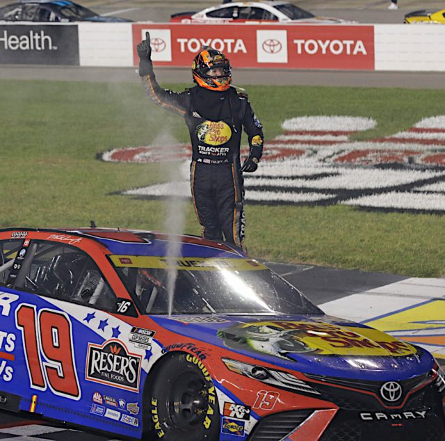Martin Truex Jr. takes the checkered flag to advance to Round 2 in the NASCAR Cup Series Playoffs. Photo by Alan Marler/Harold Hinson Photography