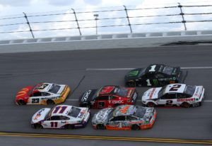 Credit: TALLADEGA, ALABAMA - OCTOBER 04: Bubba Wallace, driver of the #23 McDonald's Toyota, and Denny Hamlin, driver of the #11 FedEx Express Toyota, lead a pack of cars during the NASCAR Cup Series YellaWood 500 at Talladega Superspeedway on October 04, 2021 in Talladega, Alabama. (Photo by Sean Gardner/Getty Images)